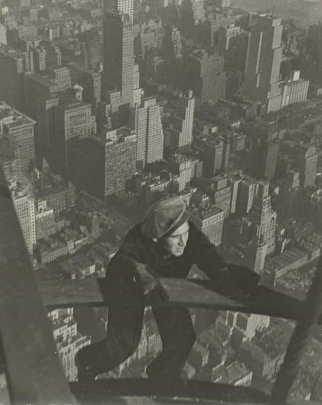 A Worker Hanging Onto Two Stee... is listed (or ranked) 1 on the list 23 Stunning Photos of the Empire State Building Under Construction