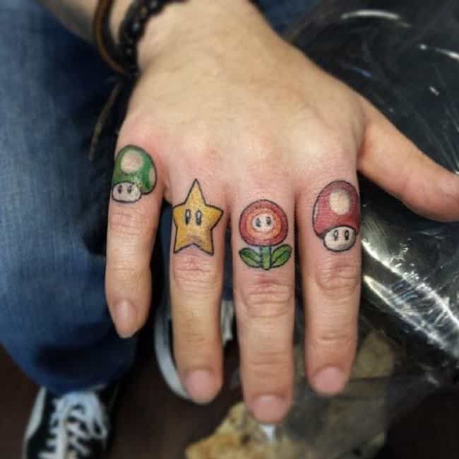 Mushroom Kingdom 4 Life is listed (or ranked) 1 on the list 24 Geeky Knuckle Tattoos That Prove Nerds Can Get Tough Too