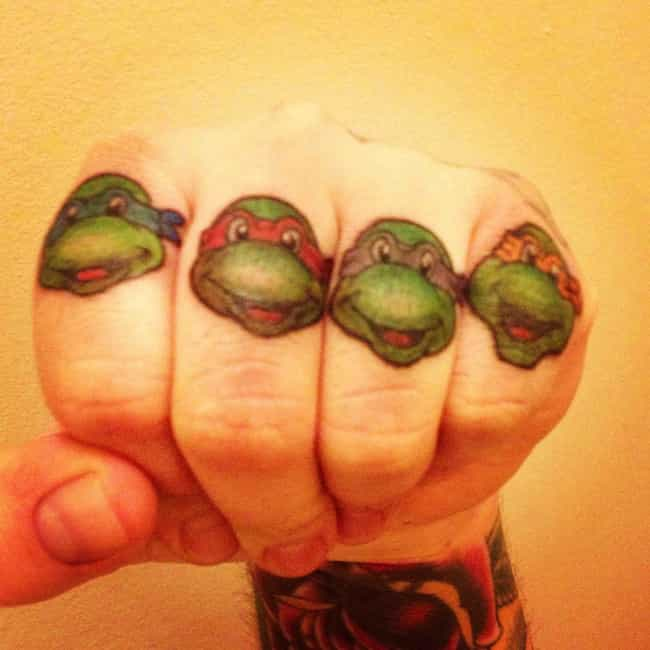 Teenage Mutant Knuckle Turtles is listed (or ranked) 4 on the list 24 Geeky Knuckle Tattoos That Prove Nerds Can Get Tough Too