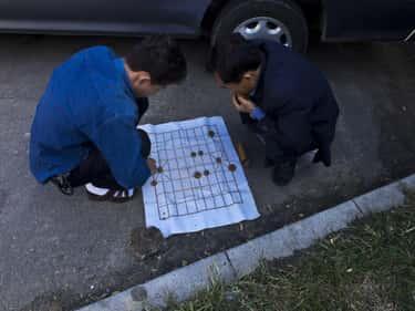 Two Men Play Korean Chess