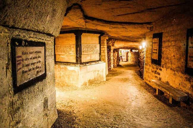 Written On The Wall: 'De... is listed (or ranked) 4 on the list 21 Haunting Photographs of The Catacombs of Paris