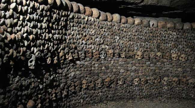 A Wall Of Death is listed (or ranked) 1 on the list 21 Haunting Photographs of The Catacombs of Paris