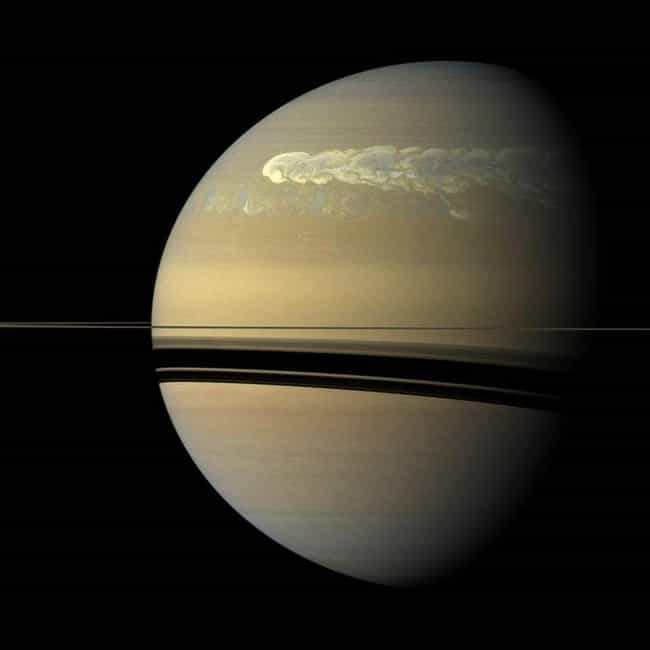 The Yellow Surface is listed (or ranked) 4 on the list The 16 Most Gorgeous Pictures Cassini Took Of Saturn Before Dying In Her Atmosphere