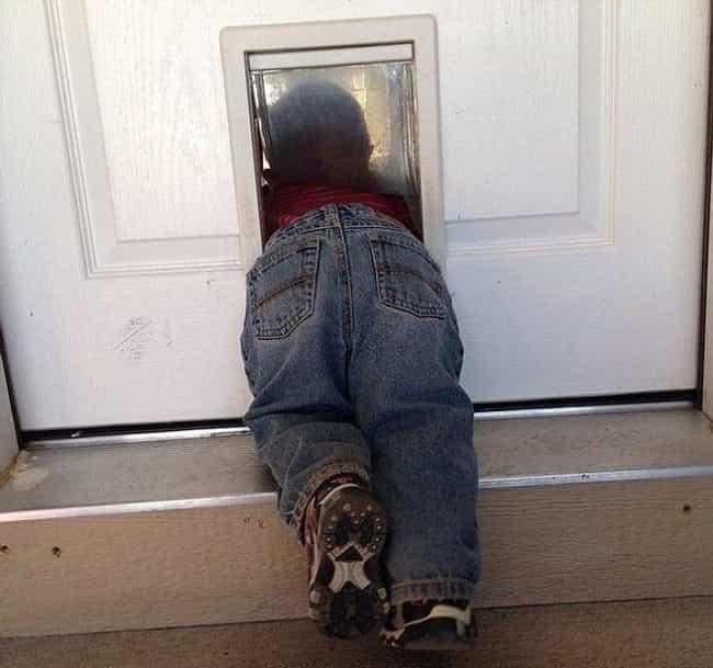 23 Hilarious Photos Of Kids With Their Heads Stuck In Unfortunate Places