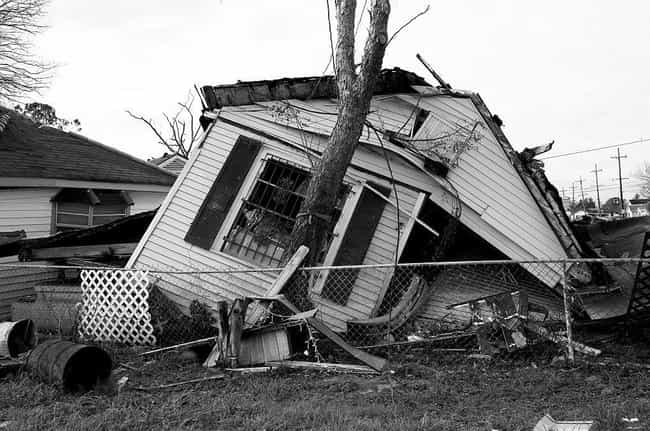 A Collapsed House is listed (or ranked) 3 on the list 28 Sobering Pictures Of Hurricane Katrina's Aftermath