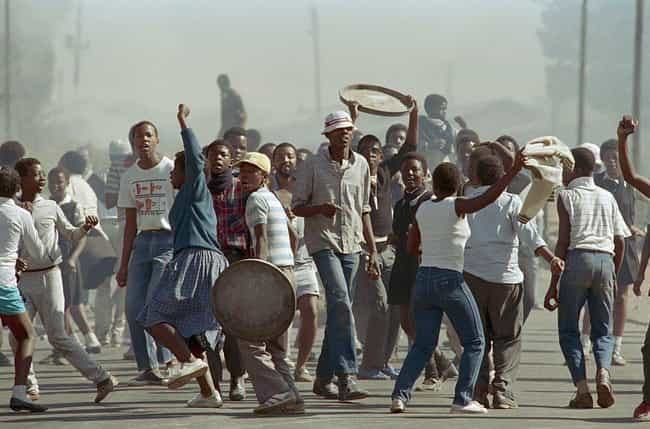 High School Students Protest A... is listed (or ranked) 2 on the list Dark Photos Taken During Apartheid In South Africa