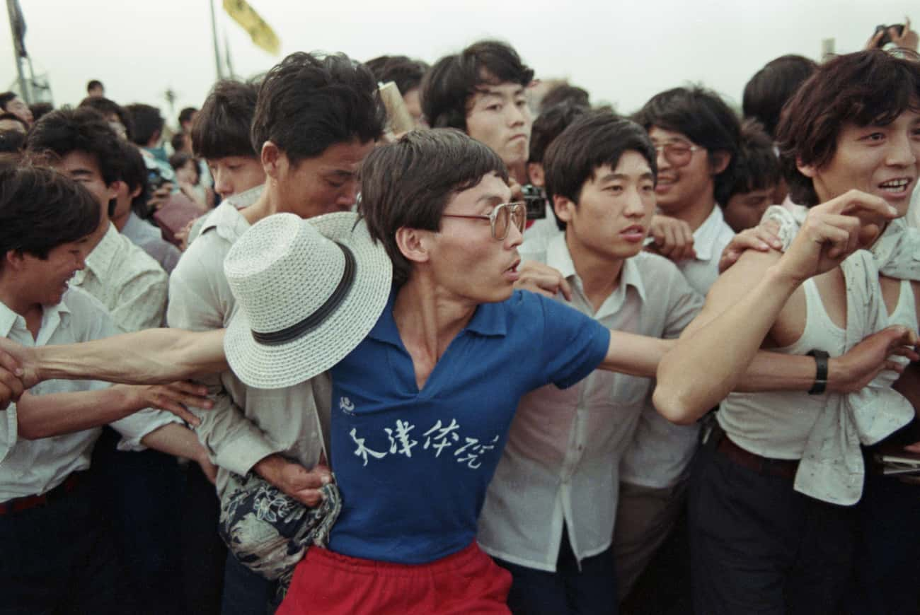 A Man Holding Back The Crowd A is listed (or ranked) 4 on the list 30 Sobering Photos Of Tiananmen Square
