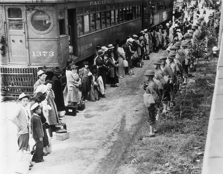 American Soldiers Guarding Japanese Americans On Their Way To The Internment Camps