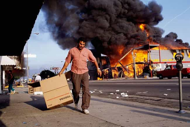 A Man Walks Past Burning... is listed (or ranked) 4 on the list 27 Unbelievable Photos From The LA Riots