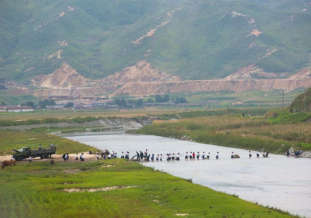 Kids Crossing A River on Random Pictures Of Rural Life In North Korea