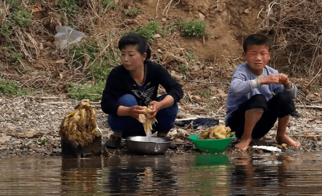 Cleaning Vegetables on Random Pictures Of Rural Life In North Korea