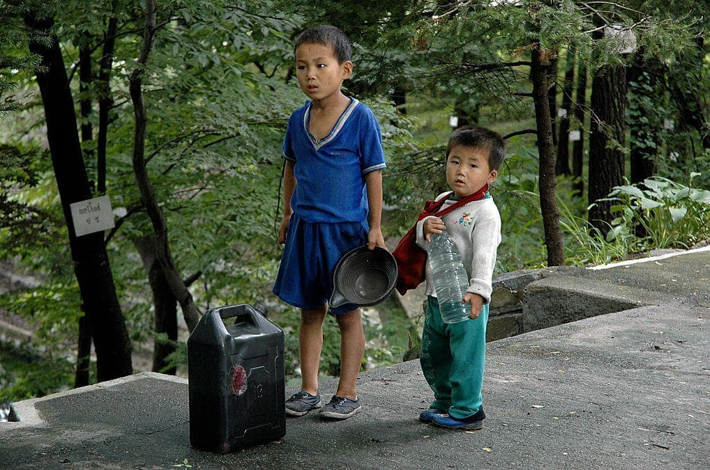 Children Take A Break From Carrying Water on Random Pictures Of Rural Life In North Korea