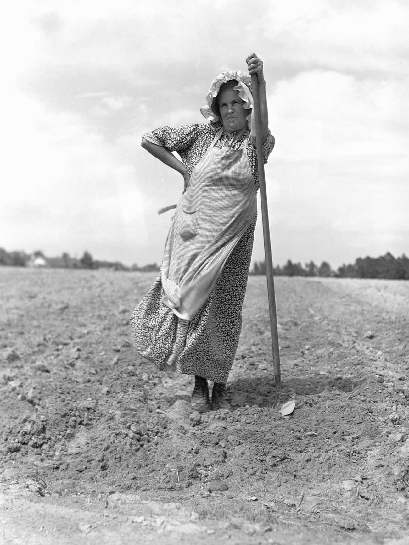 A Farm Woman Helps Her Neighbo is listed (or ranked) 3 on the list 22 Amazing Photos Of Badass Women During The Great Depression