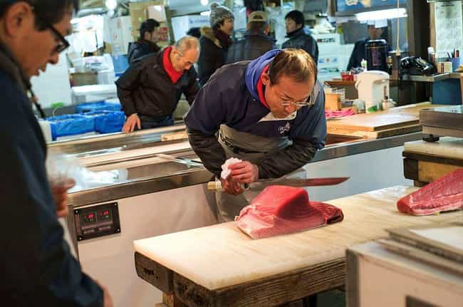 An Employee Slices Tuna ... is listed (or ranked) 2 on the list Super Nifty Pictures From The Tsukiji Fish Market