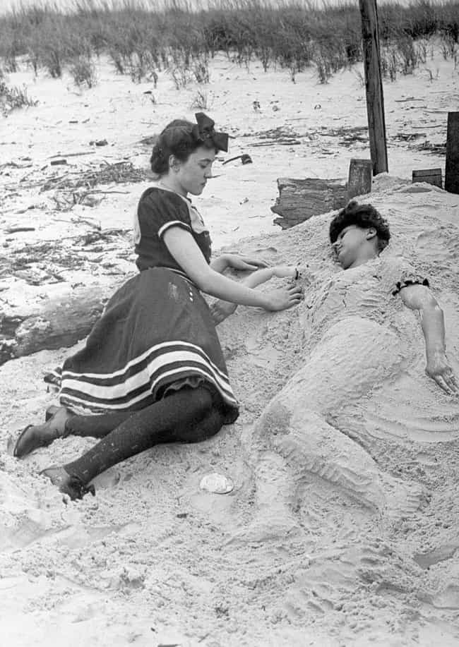A Woman Buries Her Friend On C... is listed (or ranked) 4 on the list 33 Pics of Old-Timey Swimsuits That Will Have You Dreaming of the Beach