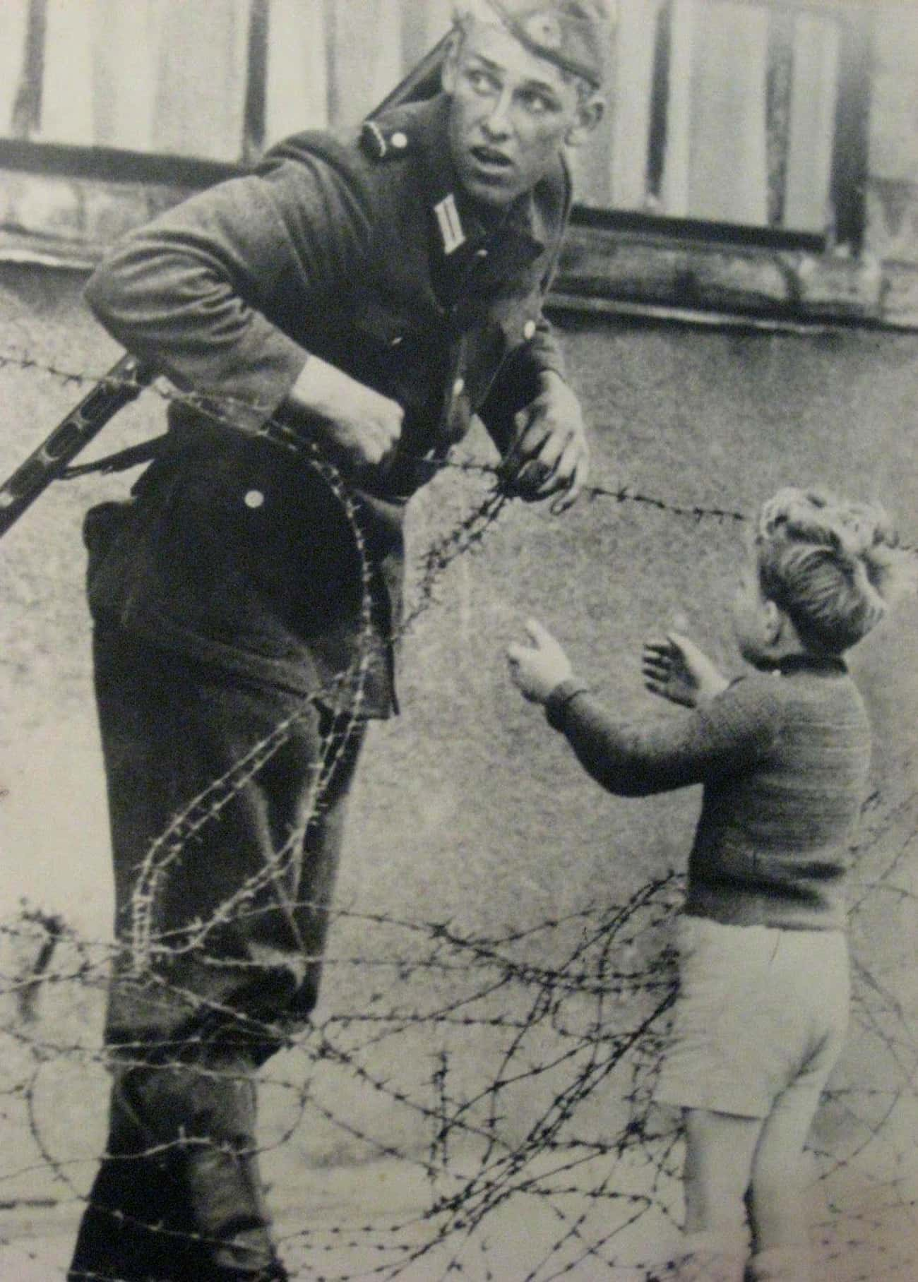One East German Soldier Floute is listed (or ranked) 1 on the list How One Heartbreaking Photo Captured The Inhumanity Of The Berlin Wall