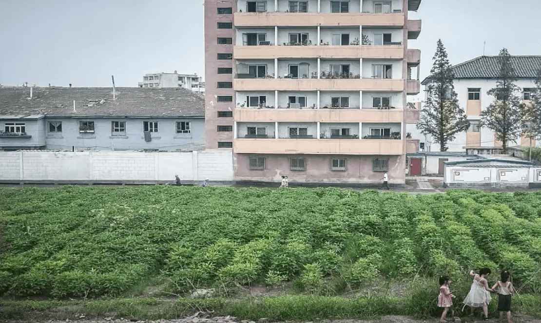 Three Girls Play Near A Dilapidated Building on Random Pictures Of Rural Life In North Korea