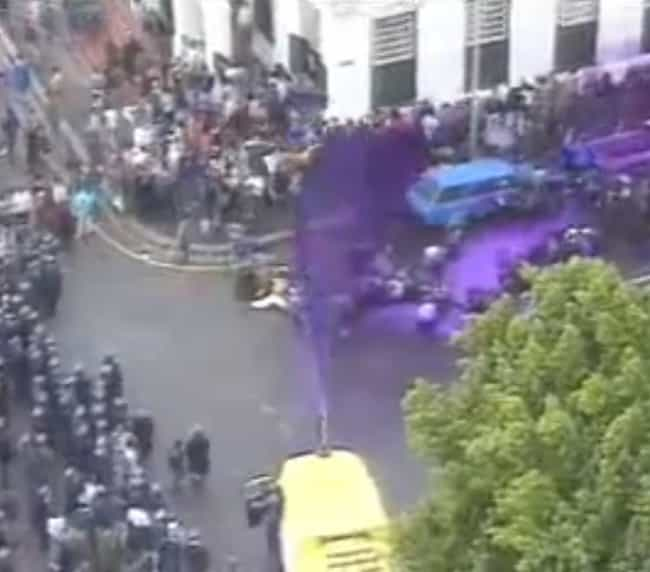 Riot Police Used Tear Ga... is listed (or ranked) 2 on the list South African Cops Blasted Anti-Apartheid Protesters With A Purple Water Cannon To 'Mark Them'