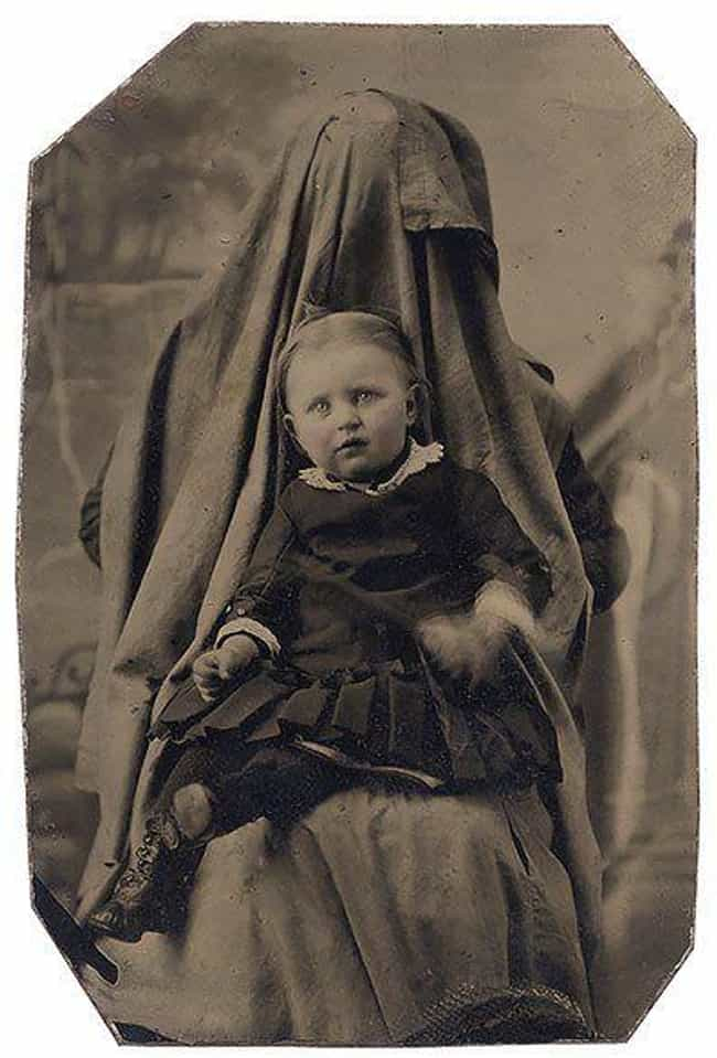 "A Child Held By A Ghoulishly S... is listed (or ranked) 4 on the list The Baffling Trend of Victorian Mothers ""Hiding"" In Photos With Their Kids"
