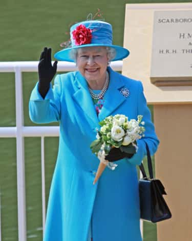 The Queen Uses Her Handbag For More Than Just Carrying Things