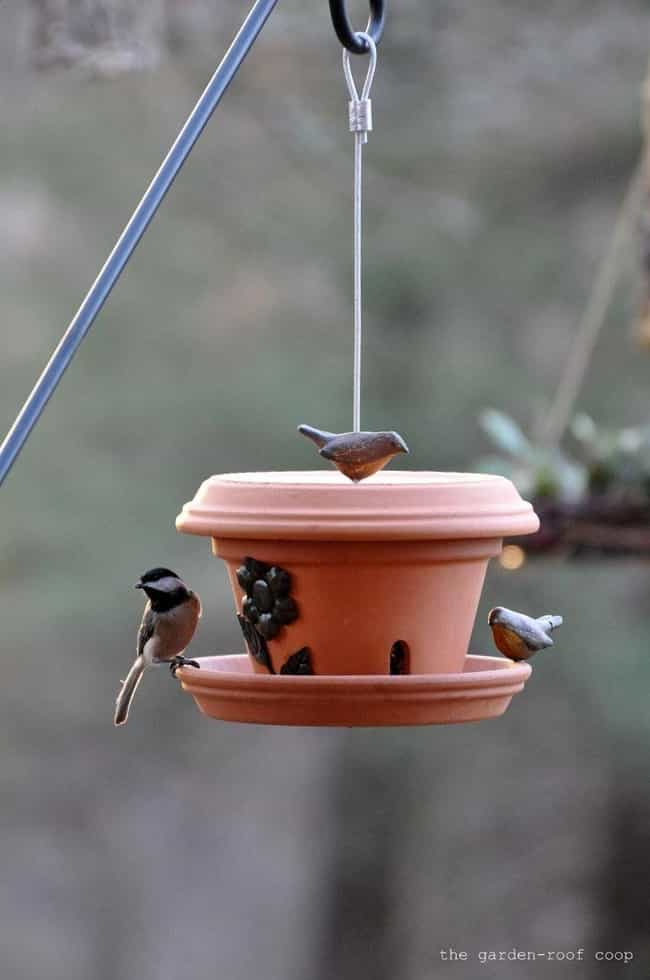 A Bird Feeder is listed (or ranked) 2 on the list Clay Pot Craft Ideas That Don't Require Any Houseplants Whatsoever