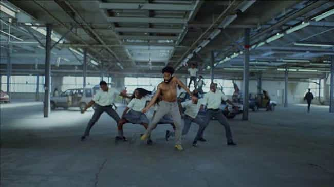 "One Particular Dance, Th... is listed (or ranked) 3 on the list All Of The Hidden Messages In Childish Gambino's ""This Is America"" Video"