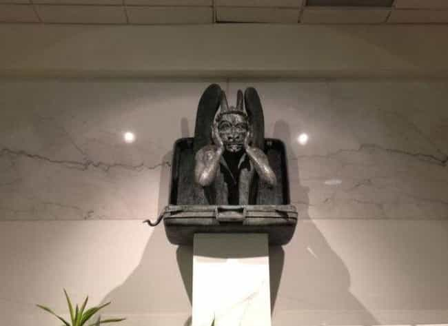 The Suitcase Gargoyle Might Be... is listed (or ranked) 4 on the list Supposed Hidden Messages In Denver Airport Artwork, According To Conspiracy Theories