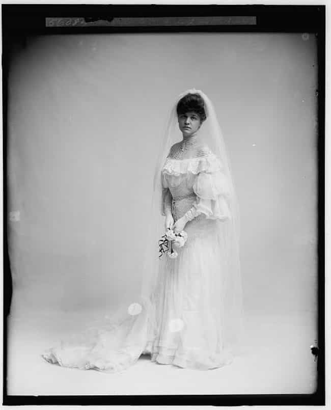 Woman In Wedding Dress Holding... is listed (or ranked) 1 on the list Hauntingly Beautiful Turn-Of-The-20th-Century Wedding Photos Show How Weddings Haven't Changed Much