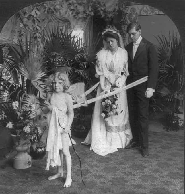 Married Couple Posing With Cup... is listed (or ranked) 2 on the list Hauntingly Beautiful Turn-Of-The-20th-Century Wedding Photos Show How Weddings Haven't Changed Much