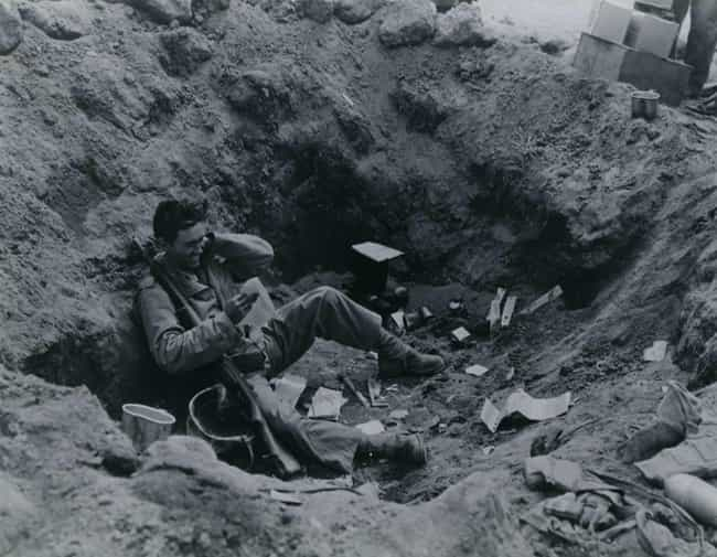 Marine Reading His Mail In A F... is listed (or ranked) 4 on the list Fascinating Photos That Show The Human Side Of WWII