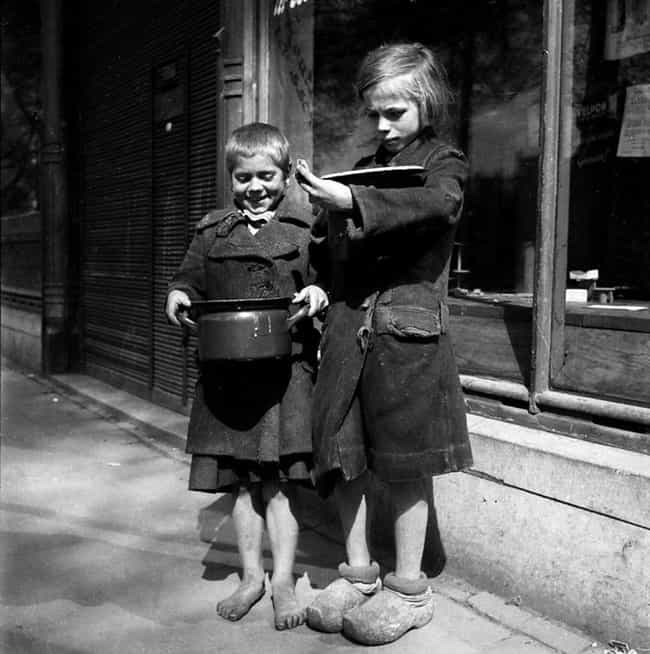 Dutch Children Receiving Bread... is listed (or ranked) 2 on the list Fascinating Photos That Show The Human Side Of WWII
