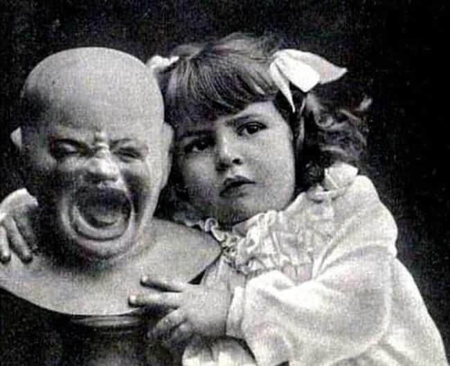 A Girl And Her Doll, Unk... is listed (or ranked) 3 on the list Historical Photos That Are Low-Key Terrifying