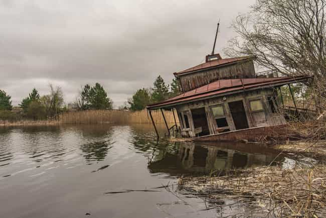 A House Sinking Into The Water is listed (or ranked) 4 on the list The Most Haunting Photos Of Chernobyl Now