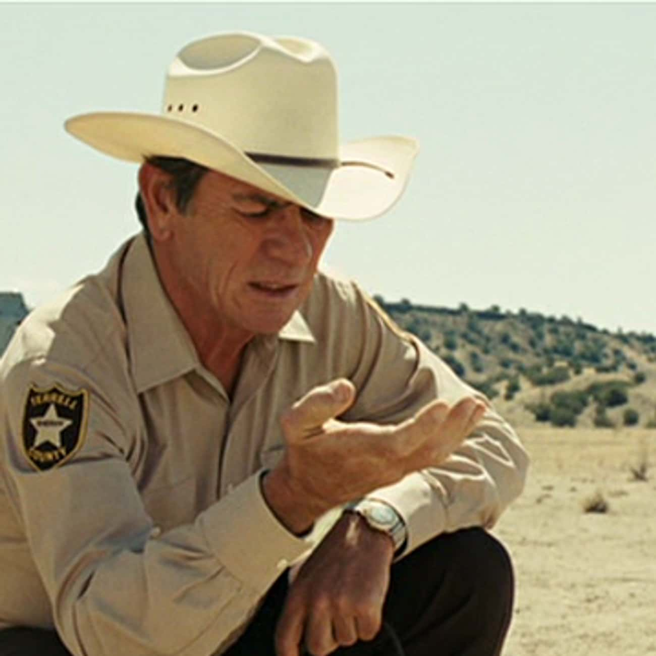 Don't Blame Him is listed (or ranked) 1 on the list The Most Memorable Quotes From 'No Country for Old Men'