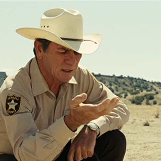 Don't Blame Him is listed (or ranked) 2 on the list The Most Memorable Quotes From 'No Country for Old Men'
