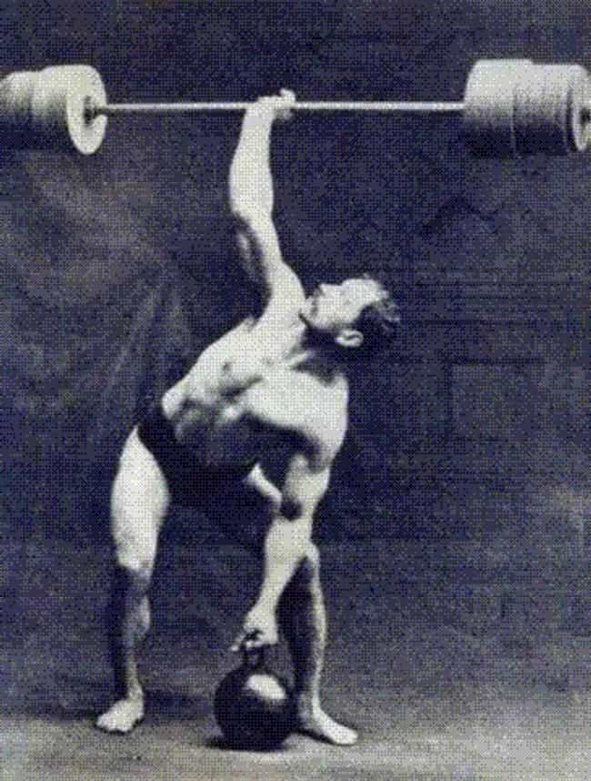 Strongman Doing An Early Bench... is listed (or ranked) 2 on the list 21 Historical Photos That Show How Working Out Has Changed Over Time