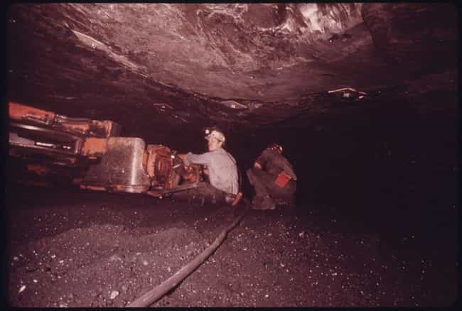 Man Collecting Coal In Tenness... is listed (or ranked) 1 on the list 17 Historical Photos Of Caves People With Cleithrophobia Should Avoid