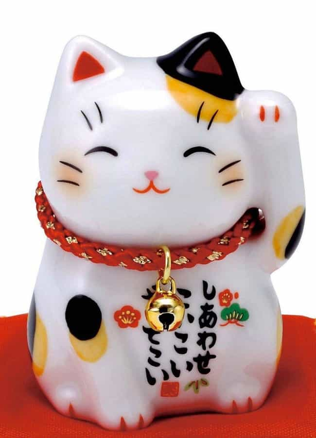 The Waving Cat Is Said T... is listed (or ranked) 4 on the list 15 International Charms That Can End Your Bad Luck Streak