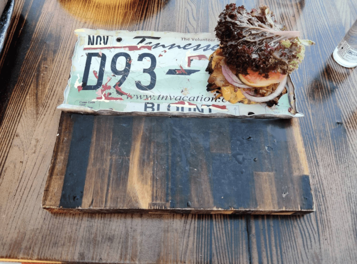 Plate... Old License Plate on Random Heinous Pictures Of Restaurants That Need To Learn How To Use Plates Correctly