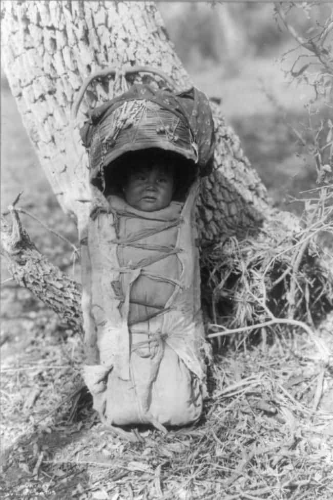 An Apache Baby In A Carrier, C... is listed (or ranked) 2 on the list Edward S. Curtis's Photographs Of Native American Life Are Hauntingly Beautiful