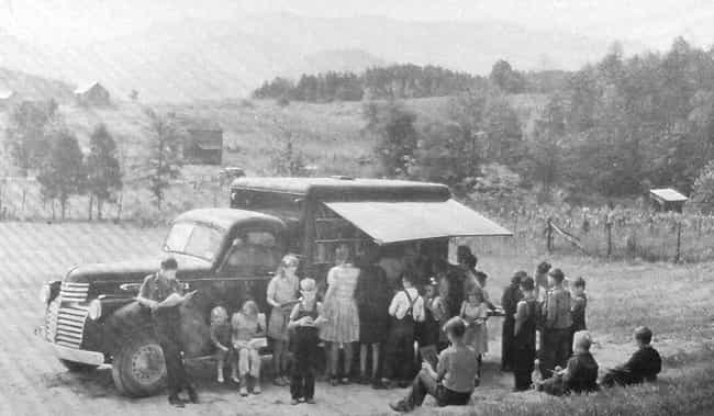 A Bookmobile Surrounded By Chi... is listed (or ranked) 3 on the list 20 Photographs From History Guaranteed To Make You Smile