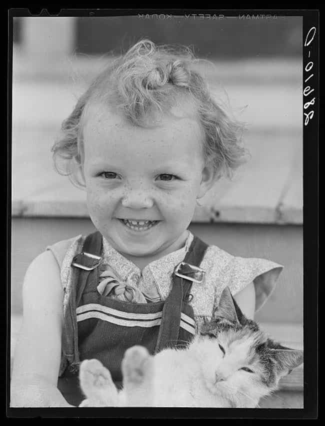 A Grinning Child Holding... is listed (or ranked) 7 on the list 20 Photographs From History Guaranteed To Make You Smile