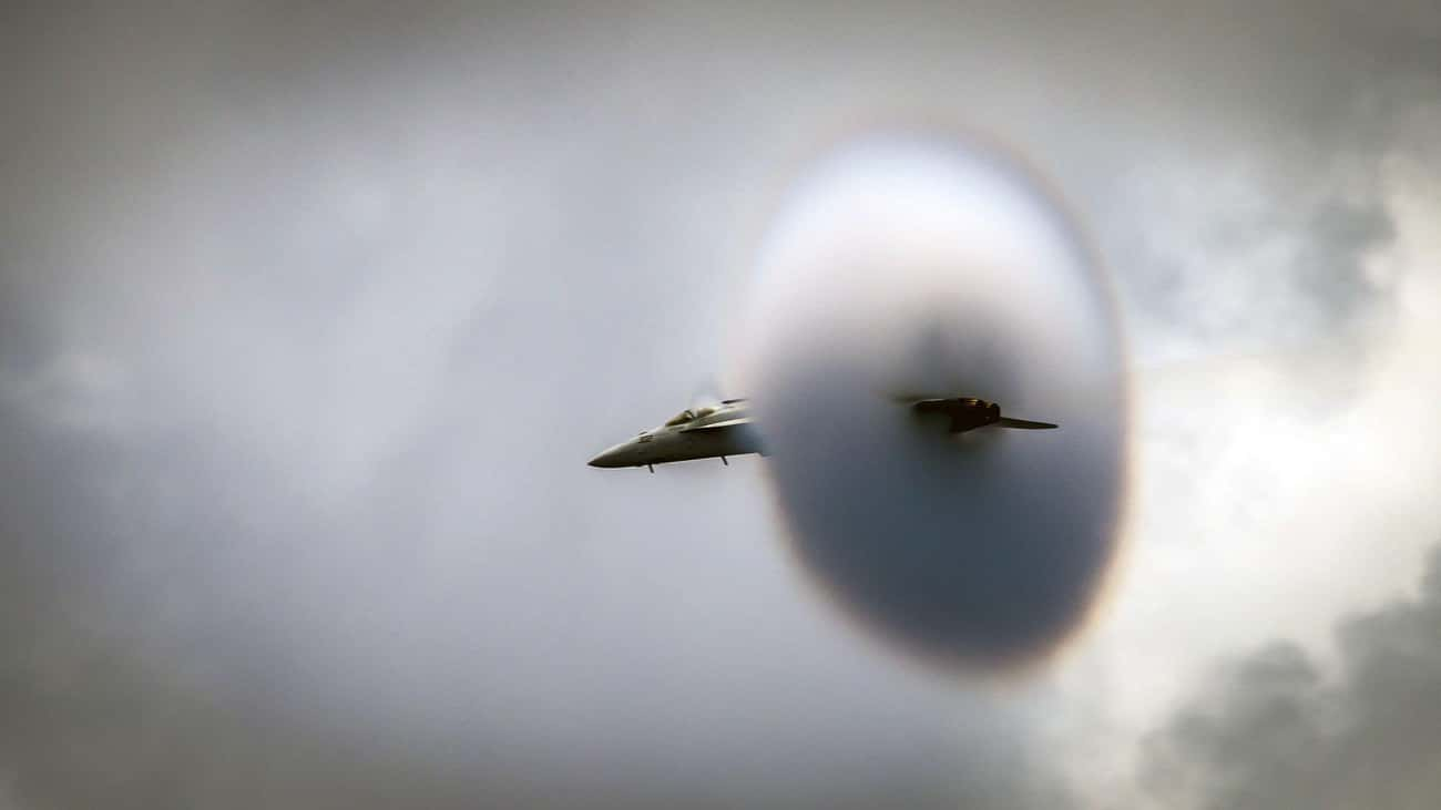 A Jet Going Through A Cloud Or is listed (or ranked) 4 on the list 32 High-Speed Photos That Freeze Time And Show You The World In A New Way