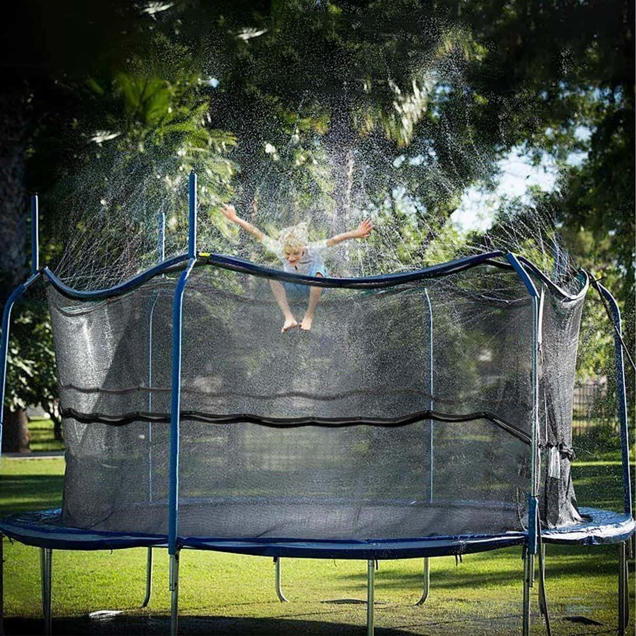 Trampoline Sprinkler is listed (or ranked) 2 on the list 13 Backyard Water Toys That Are Sure To Keep The Kiddos Busy (For A Few Mins, At Least)
