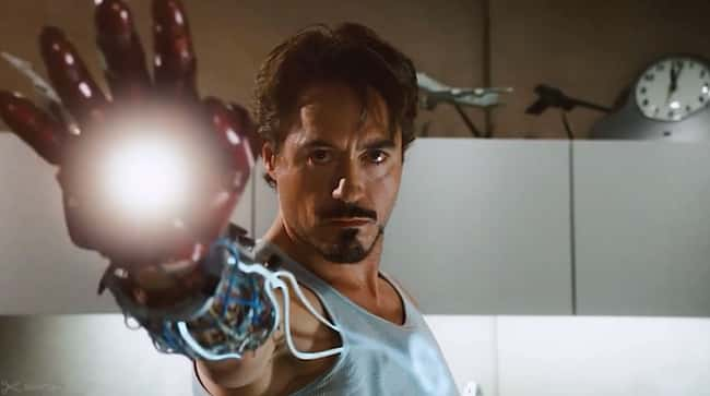 In this scene, you can see the energy moving from the Arc Reactor to his Repulsor.