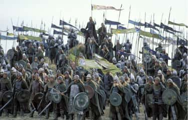 A Rohirrim Soldier Holds A Flag For The Elves Fallen At Helms Deep