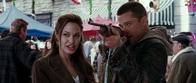 9. During the fair scene in Mr. & Mrs. Smith (2005), John (Brad Pitt) closes his left eye to aim but opens it again before shooting to maintain peripheral vision. This is what snipers do, indicating their weapon proficiency.