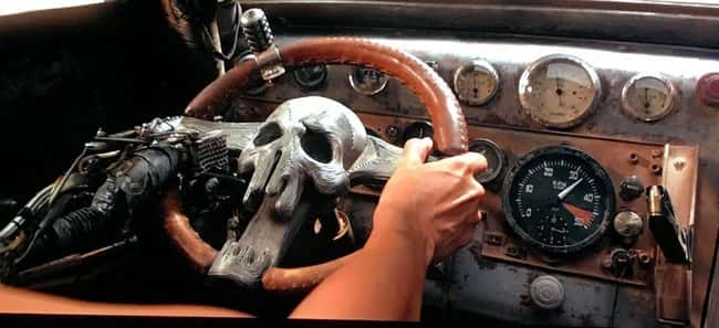 2. A gun magazine can be found on the dashboard of Furiosa's War Rig in Mad Max: Fury Road. This would make it possible for her to reload a handgun with just one hand.