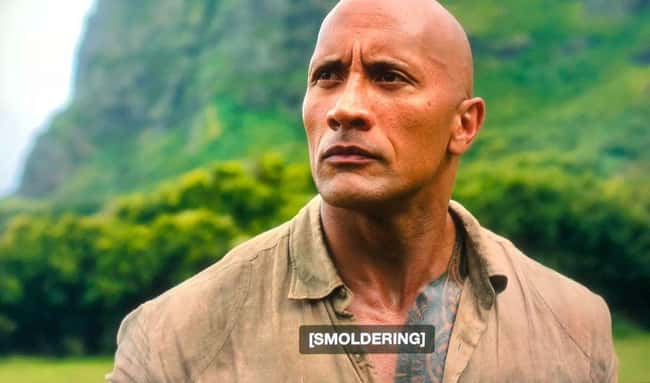 4. The Rock plays Dr. Smolder Bravestone, a video game character, in Jumanji: Welcome To The Jungle. He looks into the distance when he realizes his strength is smoldering. It's easier to understand what he's doing if you have subtitles on.