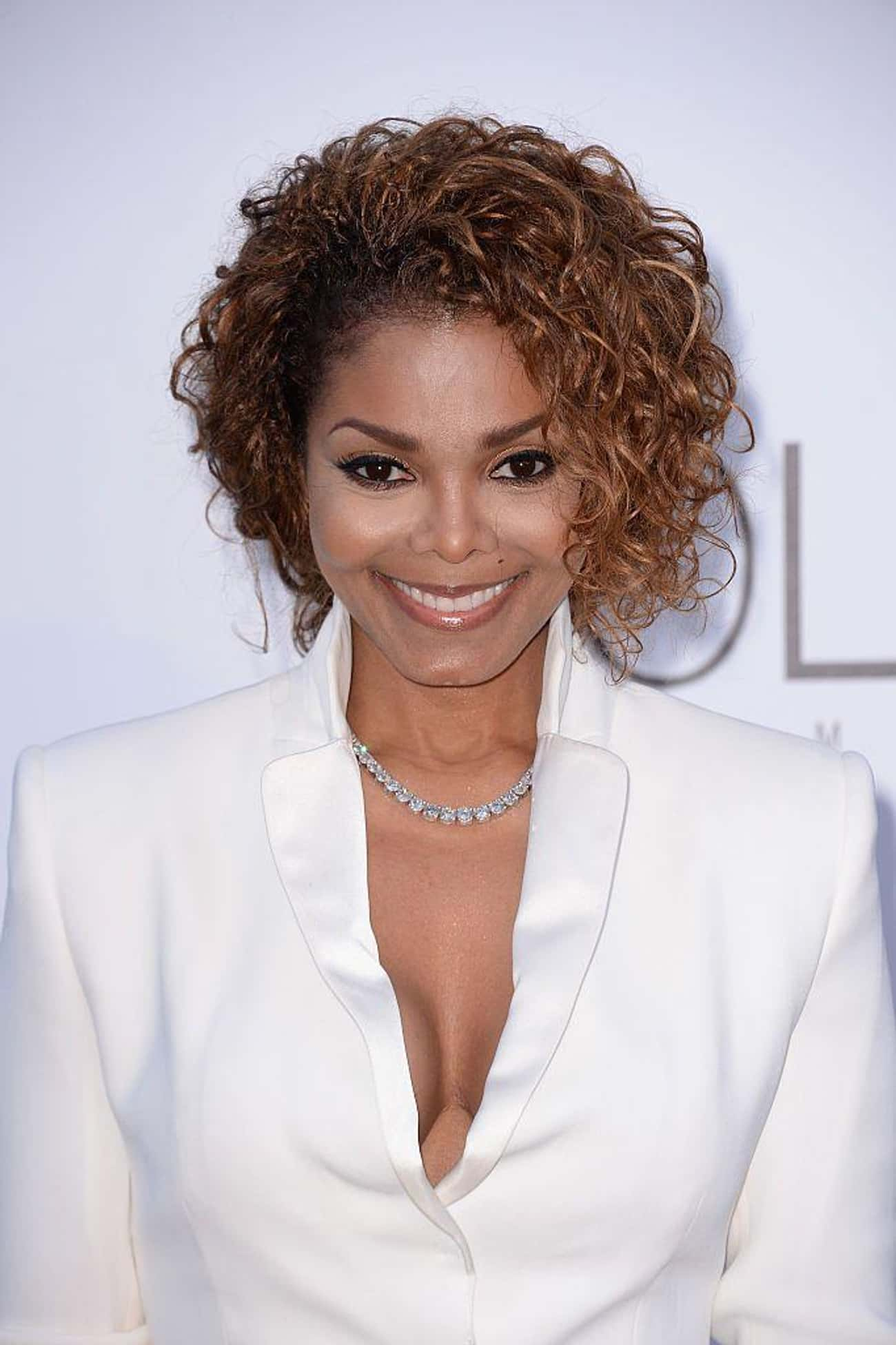 Janet Jackson is listed (or ranked) 1 on the list Famous People With Stupid Tattoos
